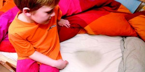 Bedwetting child with soiled bed