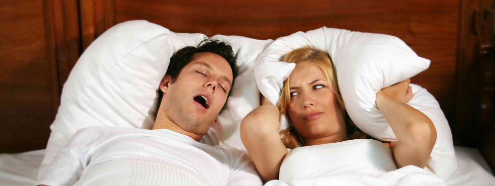 Snoring Man with frustrated bed partner
