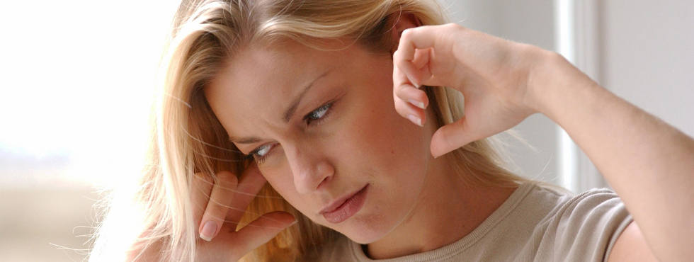 Tinnitus - a ringing, swishing, or other type of noise that seems to originate in the ear or head
